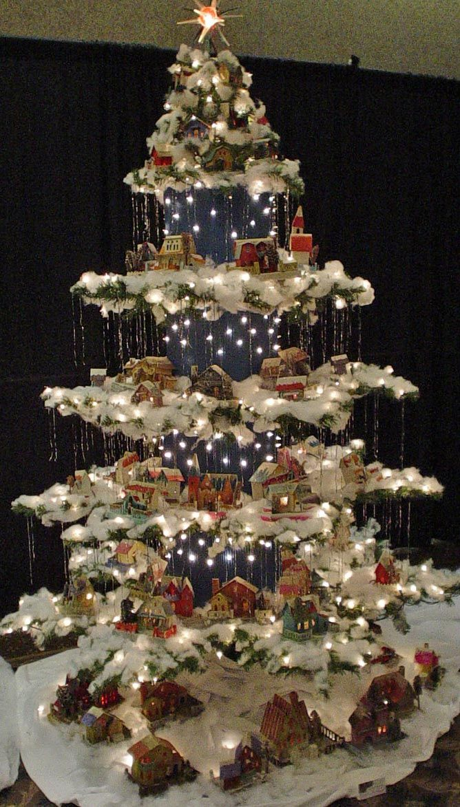 created from a regular christmas tree this antique paper house village tree was made by eliminating every 3rd row and bending the 2 remaining rows - Golden Glow Of Christmas Past