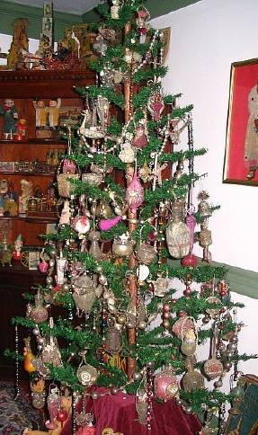Six Foot German Feather Tree Decorated With 1881 1920 Wire Wred Ornaments Antique Toys In 1800 Cupboard