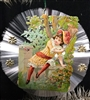 Spun Glass Ornament - Girl Sitting on Garden Wall Scrap - Dresdens by Dennis Bauer